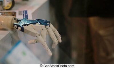 The cyborg hand. The robot hand looks like human moving the finger. Artificial Intelligence.