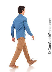 back side view of a walking young casual man