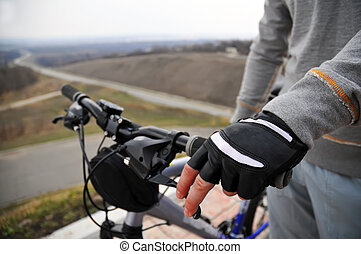 Hands on a bike handlebar - Hand of man is holding the brake...