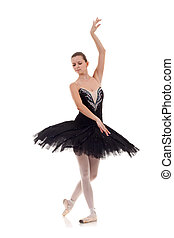 ballerina wearing black tutu posing on white background