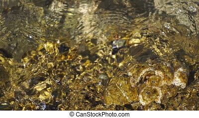 Waves roll on the rocky shore of the sea - close up of Waves...