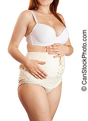 pregnant woman wearing maternity girdle - Closeup of...