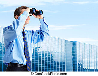 Business look - business man with binoculars looking to the...