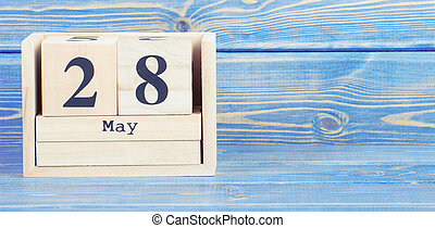 Vintage photo, May 28th. Date of 28 May on wooden cube calendar