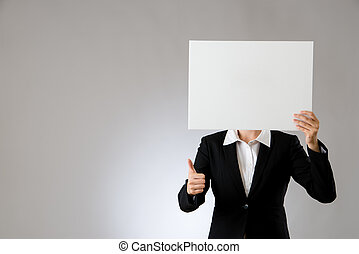 woman thumbs up with showing blank board