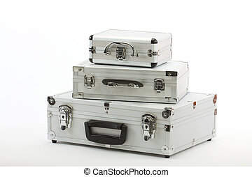 aluminium suitcases - Stack of three aluminium suitcases...