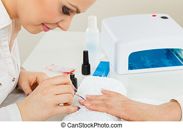 Female beautician making nails. - Profession and work....