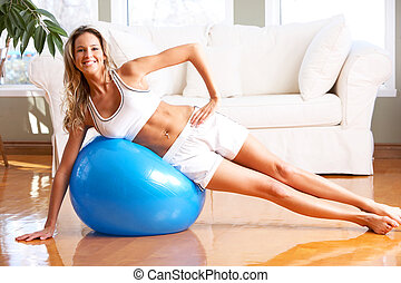 fitness - Young woman working out in the sunny room