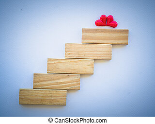 Concept of building LOVE success foundation. two red heart...