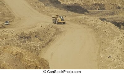 Truck on a road in quarry, day country side, dirt road...