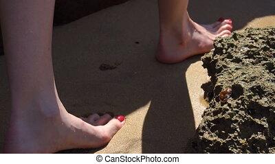 young girl is walking on the seashore