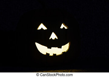 Spooky face as exterior lighting - Eerie face lit up at...