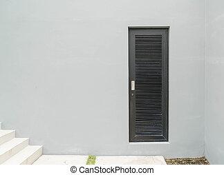 black door - empty wall with a black door