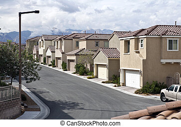 Desert Suburbia - Modern desert suburban street in the...