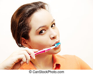 woman brushing her teeth - young woman brushing her teeth