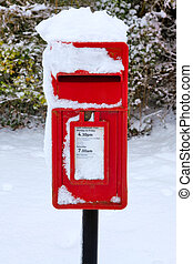 Red postbox in the snow - A traditional red English postbox...