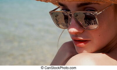young woman in straw hat and mirror sunglasses - portrait of...