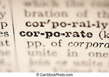 Word corporate from the old dictionary, a close up.