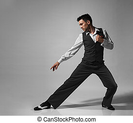 Young male professional dancer dancing in studio.