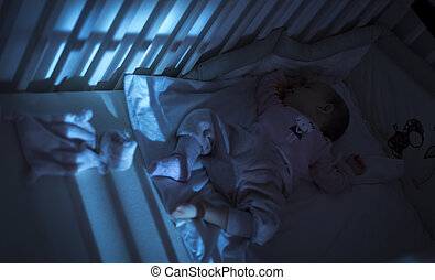 Adorable baby sleeping in blue at night - Adorable baby...