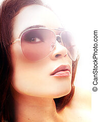 woman wearing sunglasses with hi key lighting