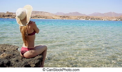 young girl with beautiful buttocks with Hat and suit sitting...