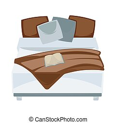 Dark double bed with pillows and open book in bedroom or...
