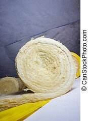 thermal insulation role in yellow package at attic...