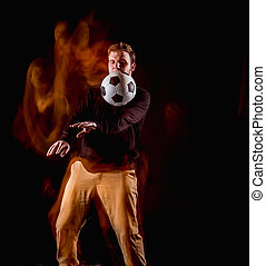 A portrait of a fan with ball on gray studio background....