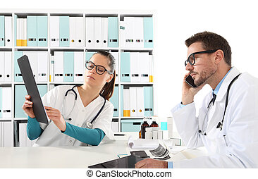 doctors with nurse looking medical records, concept of  consulting for prescription