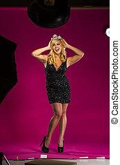 Blonde Beauty Queen - A beauty queen posing in a studio...