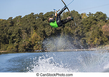 Young Wakeboarder Performing Tricks
