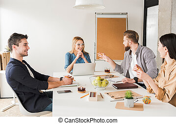 Hilarious co-workers discussing certain issues - Cheerful...
