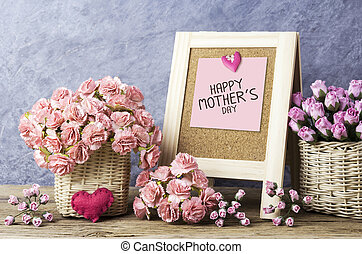 Happy mothers day message on blackboard and paper carnation and rose flowers
