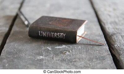 university retro idea - Vintage book with inscription...