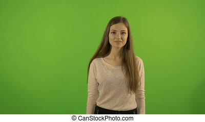 Beautiful young, white model, on a background of a green...