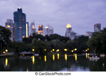Abstract blurred background of public park in the city at night