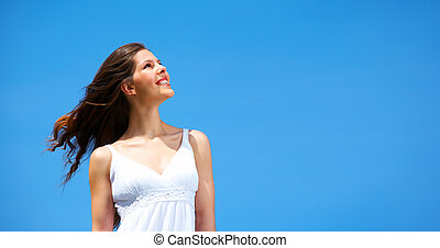 Happy woman - Happy young smiling woman in the field