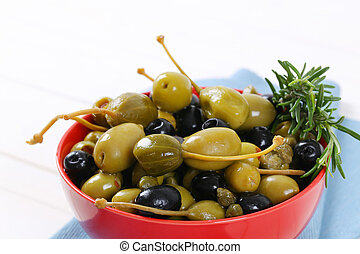 green and black olives with capers and caper berries
