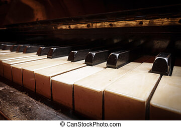 Closeup of antique piano keys, perspective view -...