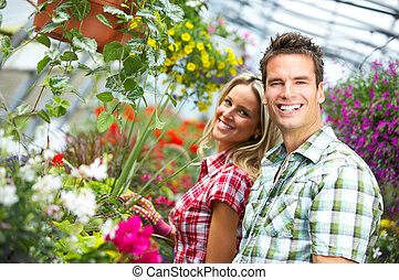 Florists - Young smiling people florists working in the...