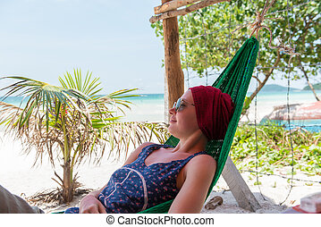 Young woman relaxes at the beach of Bai Sao, Phu Quoc...