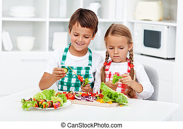 Kids preparing vegetables on a stick for a healthy snack