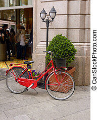 Vintage red bicycle on Italian street