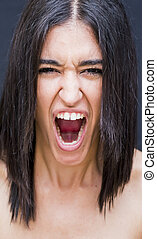 Portrait of a beautiful woman  with mouth wide open as if screaming