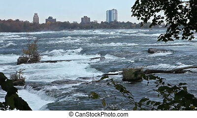 Attractions - Misty powerful Niagara river just before the...