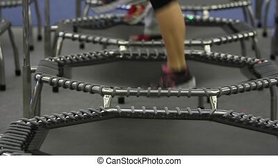 Young girl doing Fitness Exercise on a Mini Trampoline