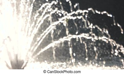 Blurred fountain in motion. Water and sunshine.
