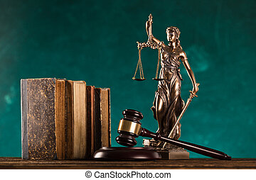 brown gavel with statue of justice.