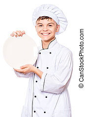 Teen boy wearing chef uniform